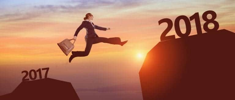 businesswoman leaping from 2017 to 2018